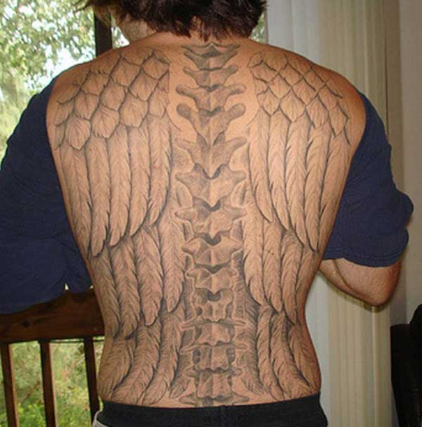 Spine tattoo on the back brings the gallant look