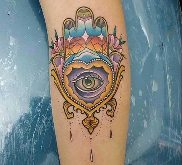 hamsa arm tattoos