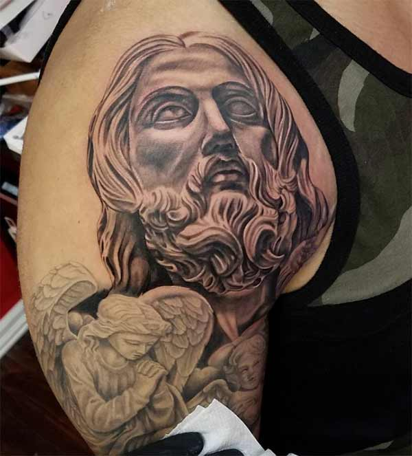 jesus tattoo on shoulder