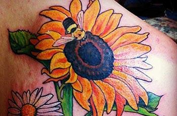 Sunflower tattoo pụtara