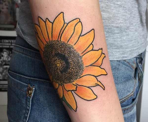 dame solsikke tatoveringer