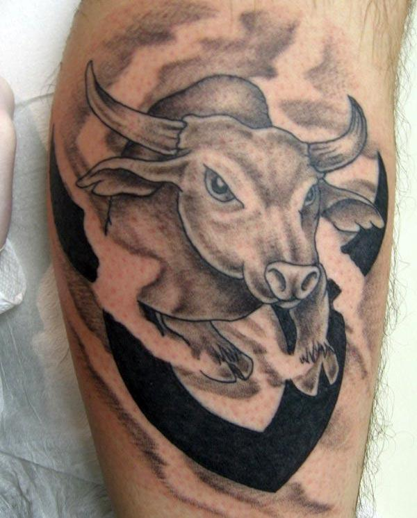 get the hunk look with black bull Taurus tattoo on upper arm