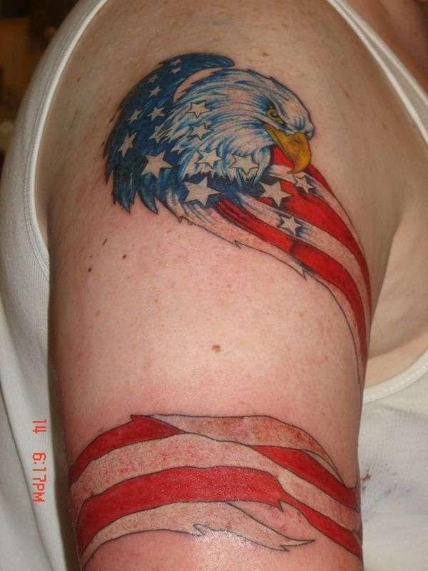 American Flag Tattoo with an eagle ink design, on the right upper arm brings the spruce appearance in men