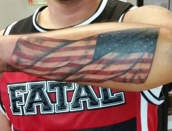 American Flag Tattoo on the lower back arm of the hand make a man look cool