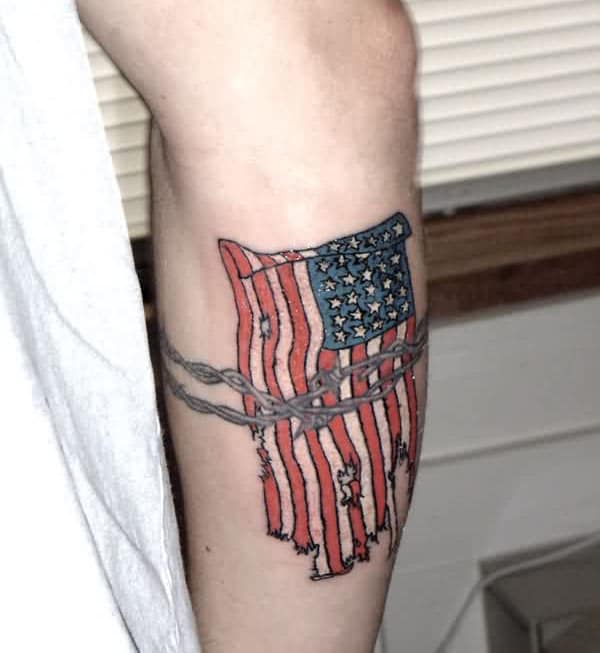 American Flag Tattoo on the lower side arm makes a man have a dapper look