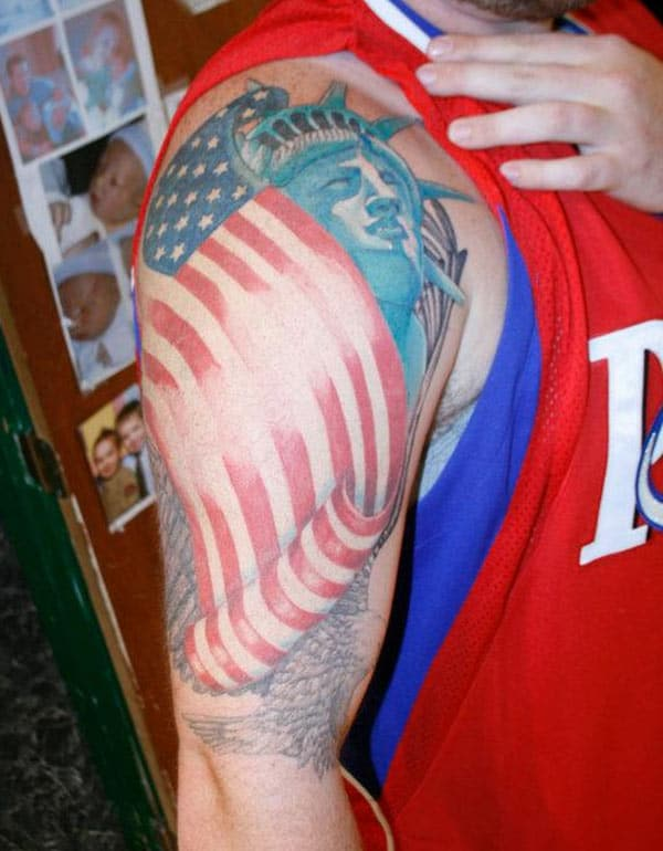 American Flag Tattoo on the right shoulder makes men appear stately