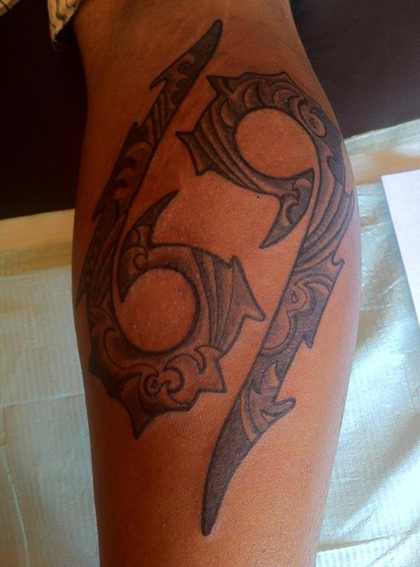 Cancer Zodiac Tattoo on front lower arm make a man look cool