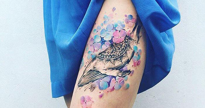 Water color thigh tattoos for women