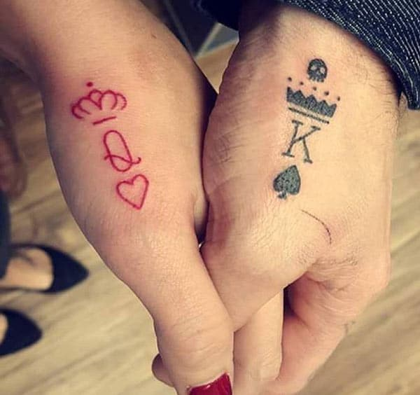 King and Queen Tattoos with black and pink ink design brings a gorgeous look