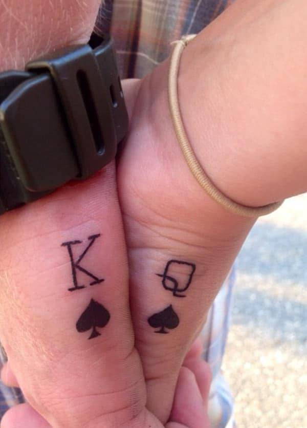 King and Queen Tattoos on the couples hand give her the fabulous gaze