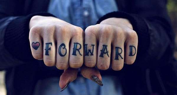 Knuckle Tattoo with a blue ink design look captivating