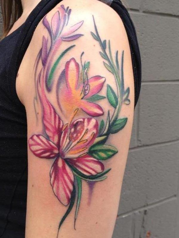 Lily tattoo on the on the shoulder brings a feminist look