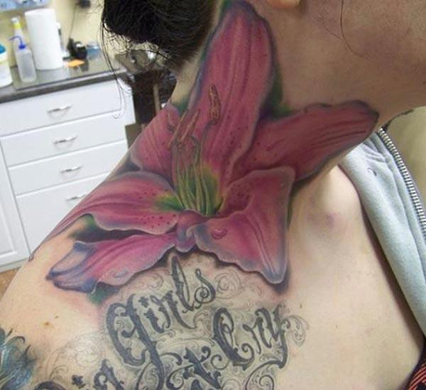 Lily tattoo on the side neck brings the feminist look