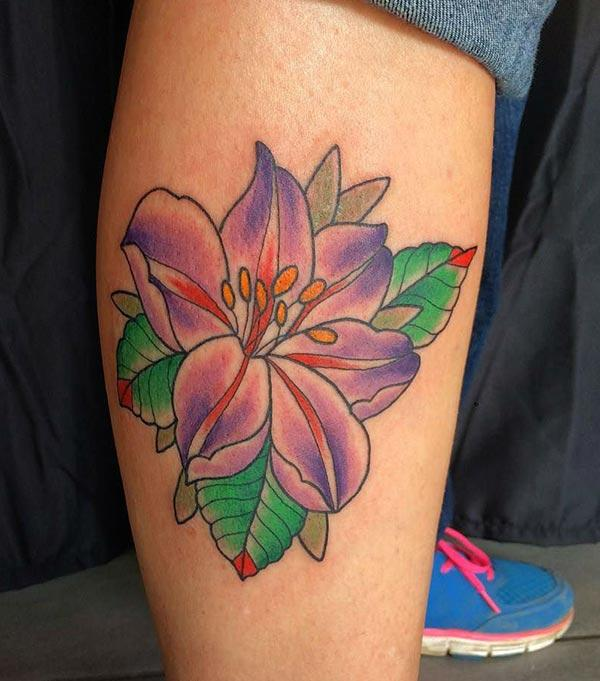 Lily tattoo on the foot makes a woman look captivating