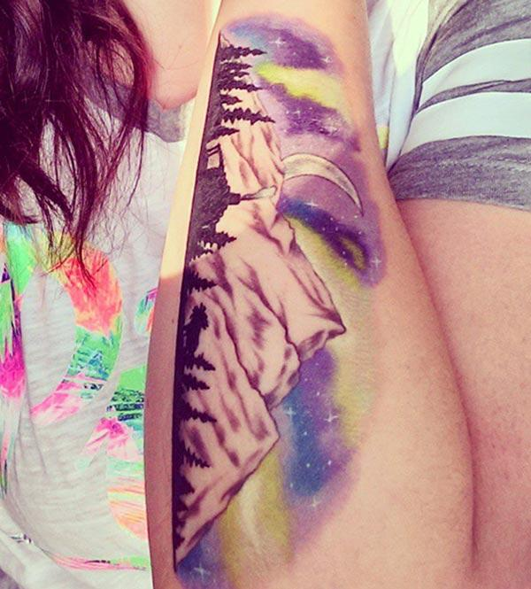 Mountain Tattoo on the lower arm makes a girl pretty