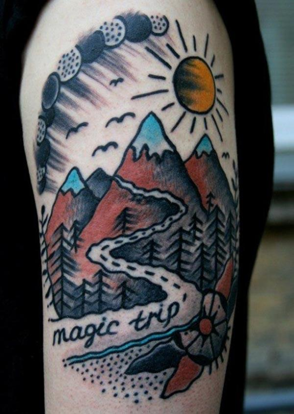 Mountain Tattoo on the upper arm makes a man look galleant