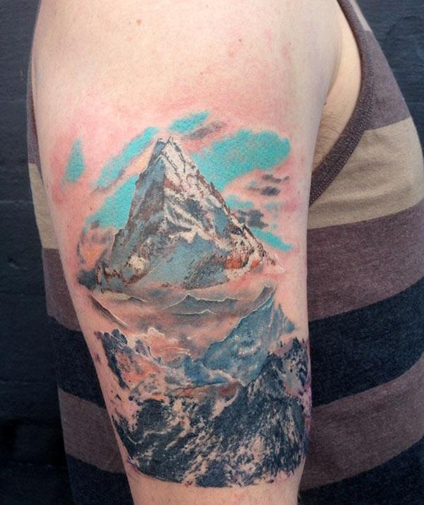 Mountain Tattoo on the shoulder makes a man look majestic