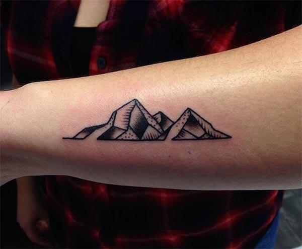 Mountain Tattoo on the lower arm makes a girl look captivating
