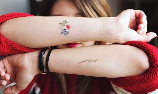 Tiny tattoo for Women with a flower design; makes them look charming