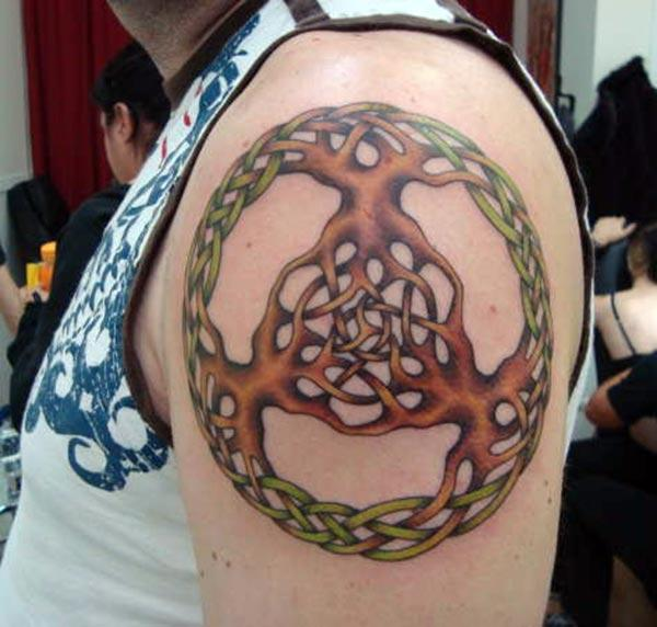 Tree of Life tattoo with a brown ink design, on the left upper arm brings the spruce appearance in men