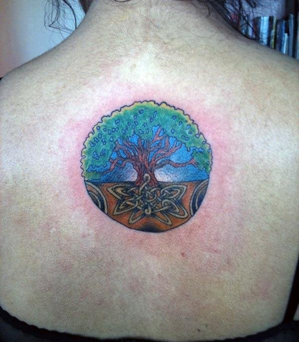 Tree of Life tattoo at the back make ladies look more glamorous