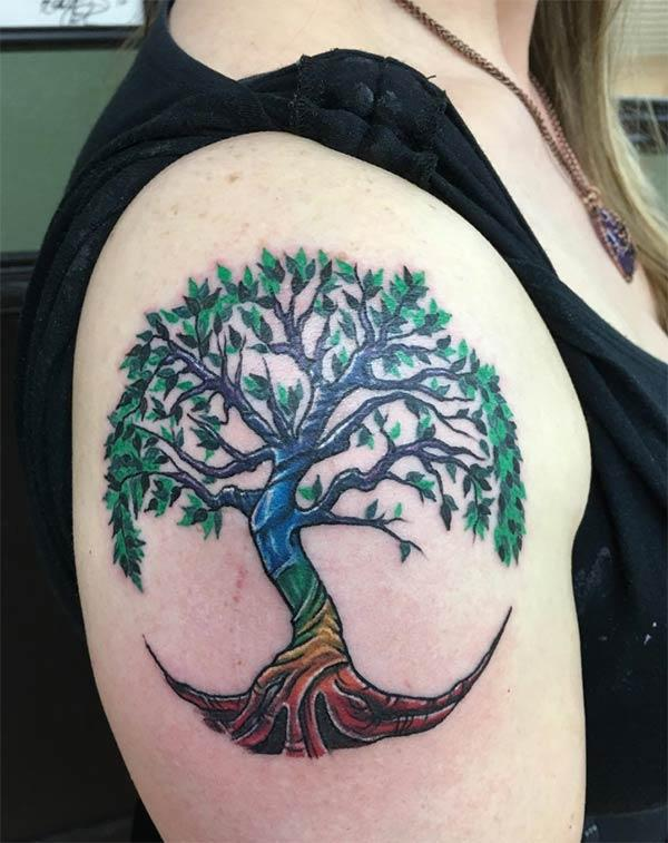 This Tree of Life tattoo design with a colorful ink makes the left arm look fabulous
