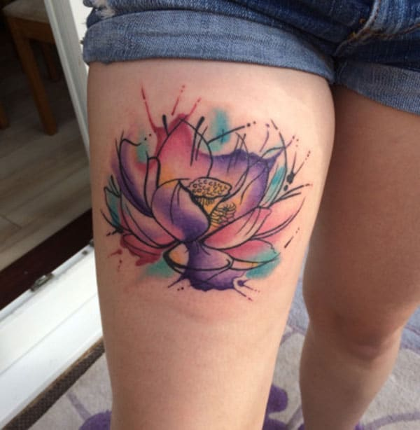 Watercolor tattoo on the thigh makes a girl look sexy and attractive