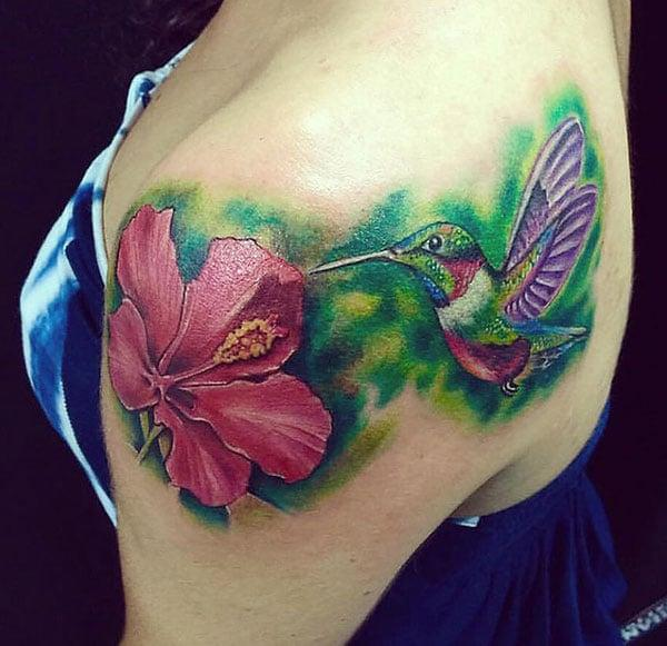 Watercolor tattoo on the shoulder makes a lady appear stunning