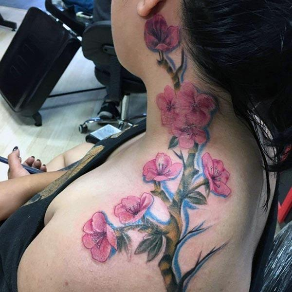 The blue ink mix design Cherry Blossom on the back of the neck make girls attractive