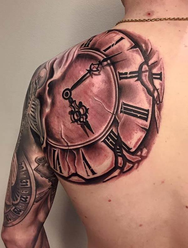 Vintage roman numeral clock tattoo ink idea for shoulder
