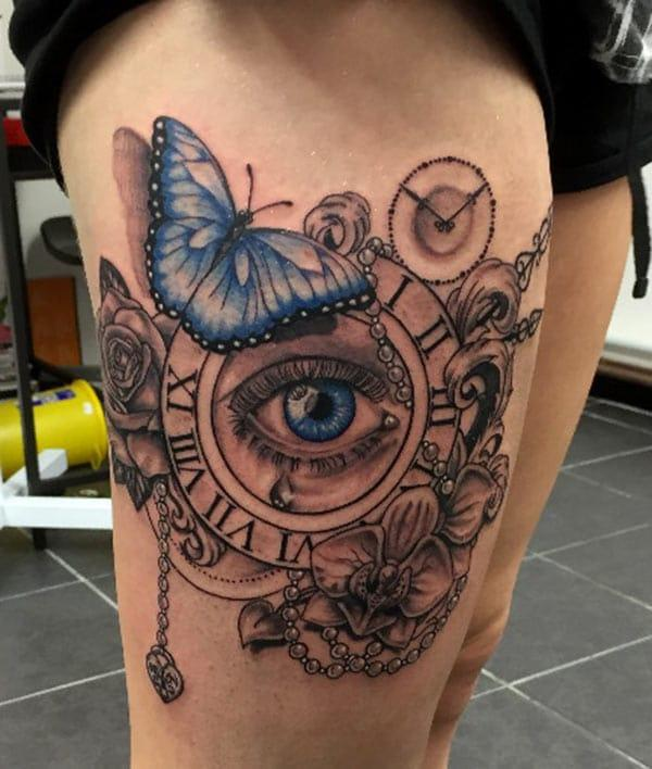 Butterfly and Roman numeral clock tattoo ink idea for thigh
