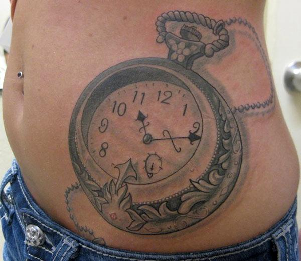 Cool antique pocket clock tattoo design idea on stomach