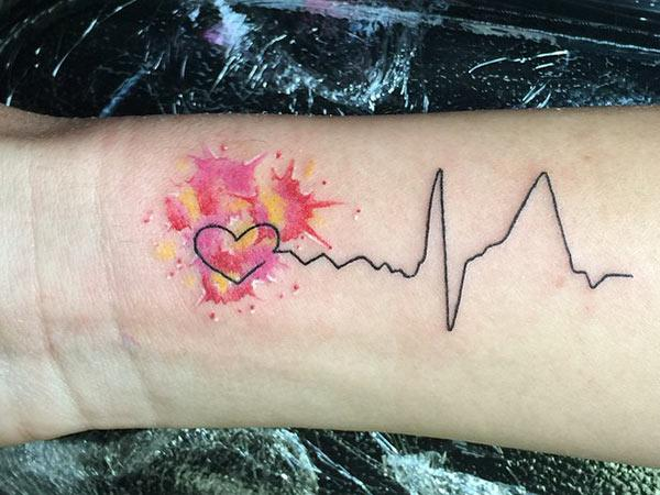 Heartbeat Tattoo on the wrist makes a girl look loyal and lovely