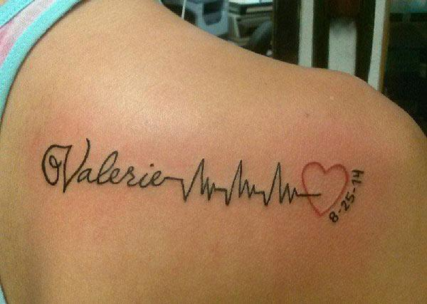 Heartbeat Tattoo on the back shoulder make a girls look attractive