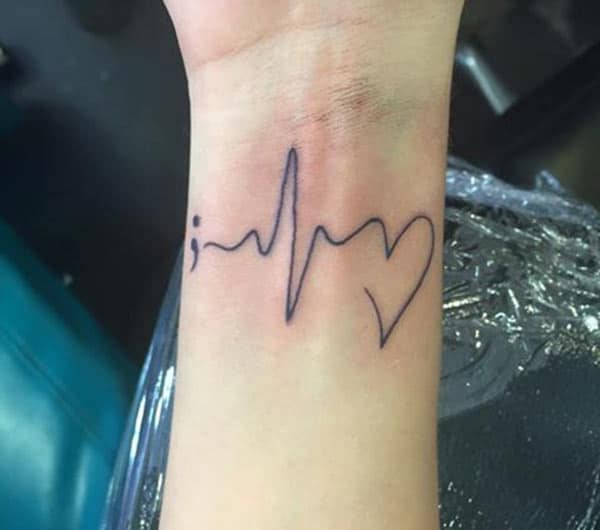 Heartbeat Tattoo at the wrist makes a girl look captivating