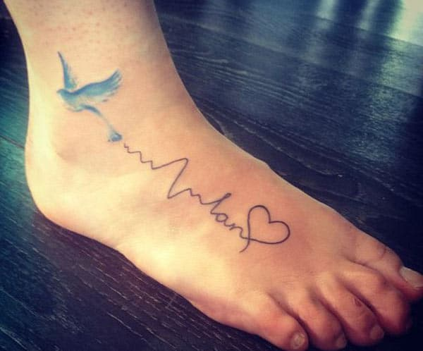 Heartbeat Tattoo with a dove on their foot make a girl look adorable