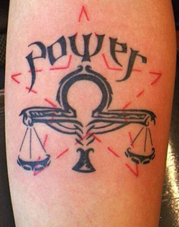 This tattoo design is made up for the inside elbow with balance symbol