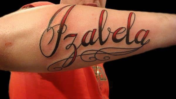Name Tattoo on the lower arm makes a man look cool