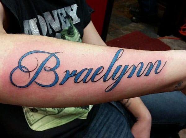 Name Tattoo on the lower arm brings the cute look