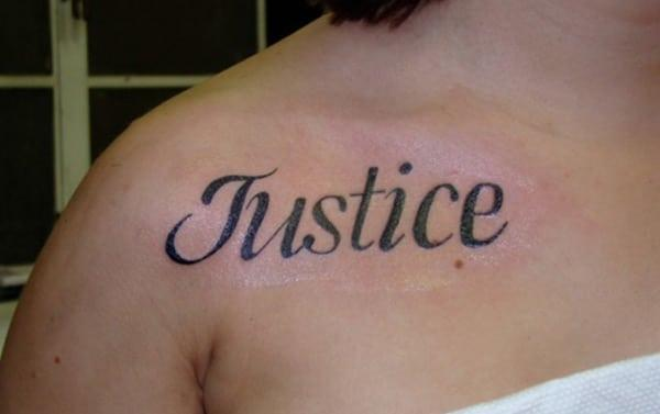 Name Tattoo on the upper chest brings a feminist look