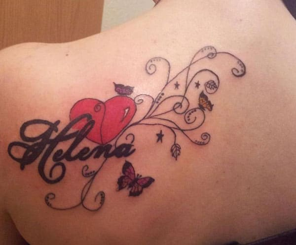 Name Tattoo on shoulder back brings the look feminine