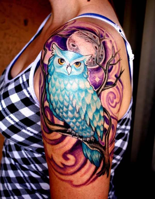This Owl Tattoo design with a colorful ink makes the left arm look fabulous