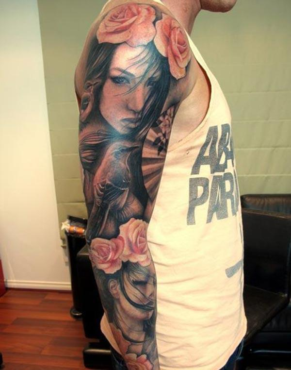 The Amazing Tattoo on the upper right arm with a pink flower design make a man look admirable