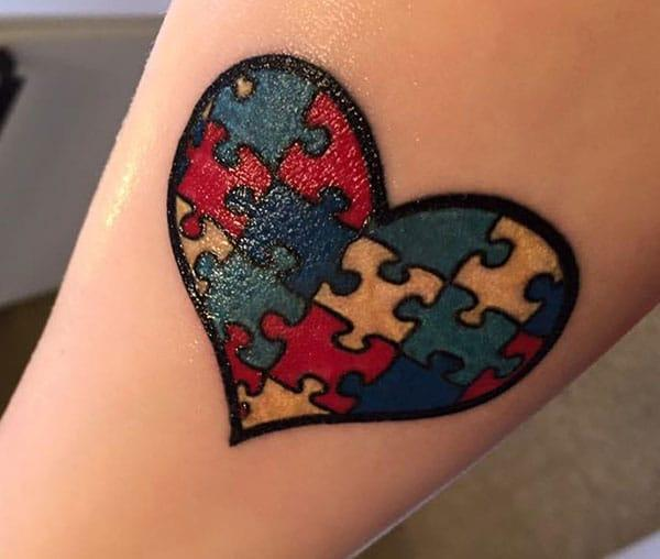Autism Tattoo with a black ink outline love, design makes a woman look captivating