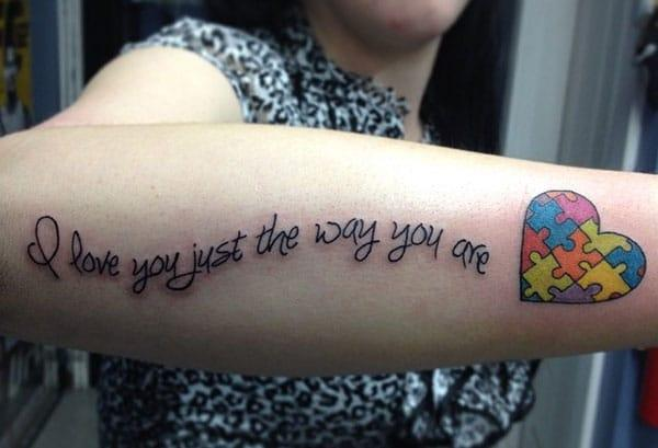 Girls go for Autism Tattoo at the back of their lower arm to bring their pretty look.