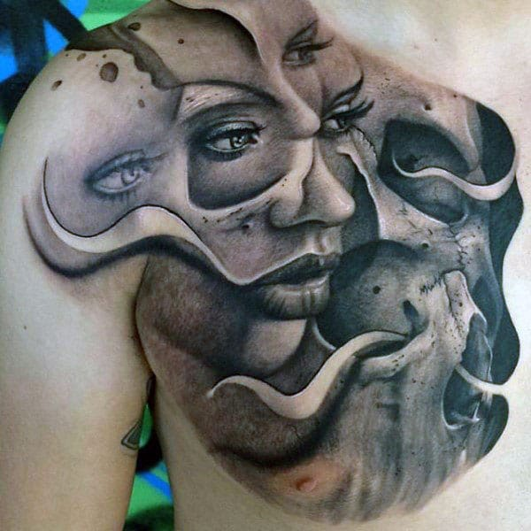 Awesome Tattoo on the chest with a face of dark ink design makes a man look gallant