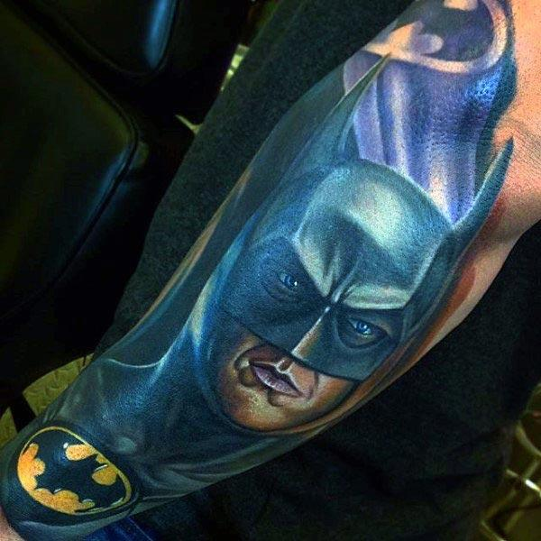 Batman tattoo on the lower back arm of the hand make a man look cool