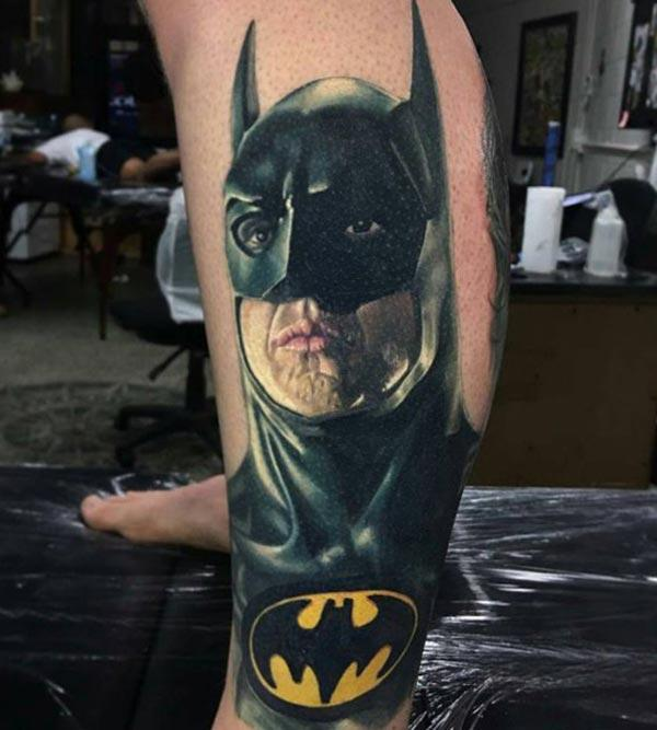 Batman tattoo on the foot make a man look swagger