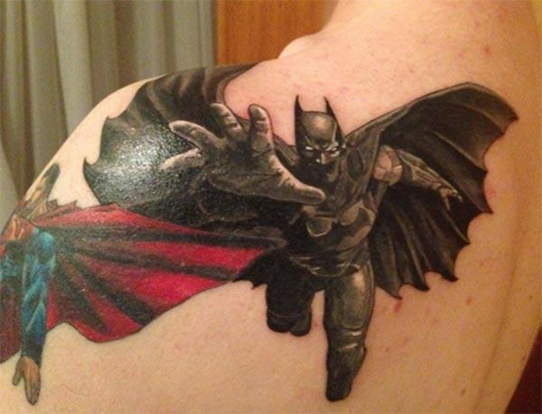 Batman tattoo on the shoulder bring the flashy look