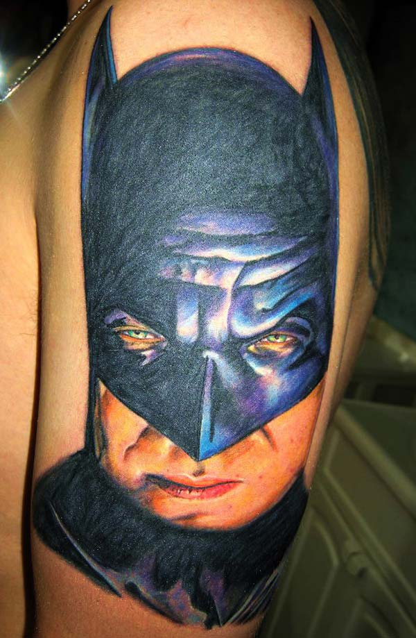 Batman tattoo for the shoulder gives the captive look in girls